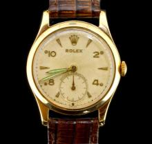 9ct yellow gold Rolex wristwatch, circular white dial with alternating Arabic numerals, subsidiary dial at six o'clock, inlaid luminous hands, approximately 30mm Dennison made case, circa 1950s and complimented by a brown leather alligator textured strap