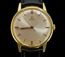 18ct yellow gold gentlemen's Omega wristwatch, circular sunburst dial, applied gold baton hour markers, case width approximately 34mm not including Omega signed crown, manual 286 Omega calibre, circa 1960's, black crocodile grain Omega strap and gold plated Omega signed buckle