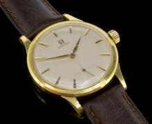 18ct yellow gold gentlemen's Omega wristwatch, circular white dial, applied gold baton hour markers, subsidiary seconds at six o'clock, circa 1960s, calibre 268 manual wind, case diameter approximately 35mm and made from full 18ct yellow gold, accompanied by a brown camelgrain leather watch strap