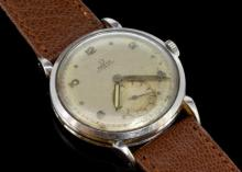 Gentlemen's Omega wristwatch, circular white dial with patina, subsidiary dial situated at six o'clock, outer edge minute track, alternating luminous Arabic numerals/ dot hour markers, Omega bumper movement, stainless steel case, Omega signed crown, brown leather watch strap