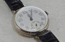 Silver cased gentlemen's trench wristwatch, circular white enamel dial with Arabic numerals at hour markers, subsidiary dial at six o'clock, case diameter approximately 34mm, case no 431***