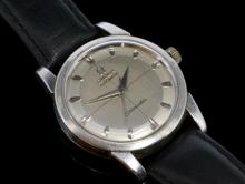 Gentlemen's Omega Seamaster wristwatch, brushed silver coloured dial with satin outer edge, applied polished hour markers, circa 1950s, calibre 354 (bumper) movement, stainless steel case diameter approximately 34mm, black leather strap