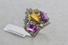 Diamond and sapphire tiara ring, pear cut yellow sapphire set with an oval cut pink sapphire to each side, old cut diamond detail, estimated yellow sapphire weight 2.96cts, estimated pink sapphire weights 2.15ct and 1.75ct, in white metal stamped and tested as 18ct, ring size O