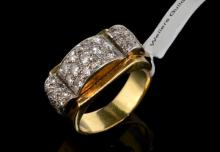 1940s continental style cocktail ring, central curved panel of old and transitional cut diamonds, with curved diamond set shoulders, set in white metal on a yellow metal shank, ring size T