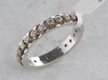 Diamond full eternity ring, single cut diamonds illusion set in white metal stamped with French standard mark for 18ct, ring size O½