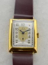 Gentlemen's Omega wristwatch, rectangular two tone dial, outer minute track, applied Arabic numerals, subsidiary dial at six o'clock, rectangular Omega signed case with hinged caseback, 15 jewel Omega signed movement, Omega signed crown and maroon leather strap