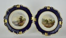 A pair of 19th century English porcelain plates, possibly Derby, finely painted with named view landscape scenes