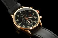 Gentlemen's T5 chronograph wristwatch, circular black dial with white Arabic numerals, substitute chronograph dials, date window situated at six o'clock, gold plated case and black leather strap