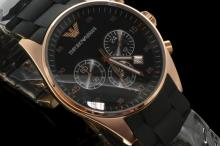 Gentlemen's Armani wristwatch, black circular dial with subsidiary chronograph dials, rose gold coloured case, date window between four and five 'clock, rubber and metal bracelet deign