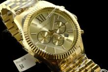 Unisex Michael Kors Lexington Chronograph bracelet wristwatch, gold coloured circular dial with Roman numerals at twelve o'clock, three subsidiary dials, baton hour markers, date window situated between four and five o'clock, quartz movement, approximately 45mm case width, box and paperwork included, RRP of £259.00