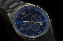 Gentlemen's Armani rubber bracelet wristwatch, circular vivid blue dial, date window between four and five o'clock, subsidiary chronograph dials, quartz movement, includes box and paperwork