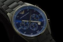 Gentlemen's Armani rubber bracelet wristwatch, circular vivid blue dial, subsidiary chronograph dials, black case, quartz movement and includes box and paperwork