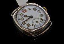 Gentlemen's silver cushion cased wristwatch, circular white enamel dial with Arabic numerals, secondary dial at six o'clock and 15 jewel manual movement