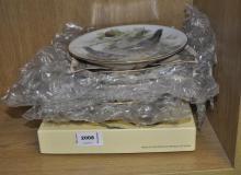 Eight World Wildlife Fund collectable bird plates