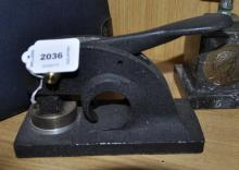 A black steel seal press in the lock position