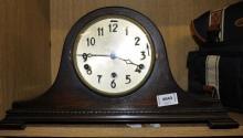 An oak mantel clock