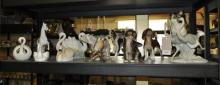 A collection of animal ornaments including a Nao porcelain figurine of two ostriches, an Austrian figure of a beagle, 19cm high and a pointer or setter,19cm high.