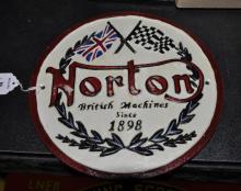 *A cast iron Norton motorcycle plaque, (Lot subject to VAT)