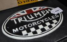 *A cast iron triumph motorcycle plaque, (Lot subject to VAT)