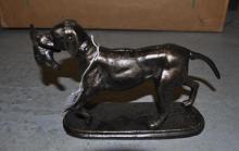 *A cast iron gun dog statuette, (Lot subject to VAT)