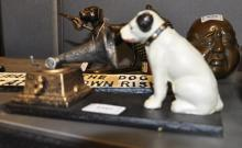 *A cast iron HMV money box, (Lot subject to VAT)