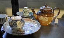 A Chinese famille rose dish, a famille verte inkpot and other ceramics