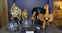 Cloisonnee egg; carved wooden elephants; ponyskin horse and other items