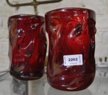 A pair of chunky cylindrical red glass vases of organic form, 18cm