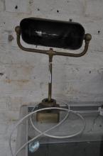 A vintage adjustable brass desk lamp.
