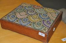 Footstool with woolwork seat