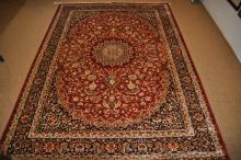 A Keshan carpet, red ground, 2.3x1.6m
