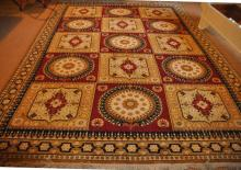 A large 20th Century Israeli mustard ground carpet