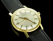 Gentlemen's 18ct yellow gold Zenith wristwatch, circular silver coloured sunburst dial, applied baton hour markers, signed crown, circa 1960s, 17 jewel Zenith signed movement, signed case, black leather strap