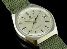 *Gentlemen's Junghans wristwatch, circular silver brushed dial, applied baton hour markers, quartz movement, date aperture situated three o'clock, inlaid baton hour markers, khaki green strap (Lot subject to VAT)