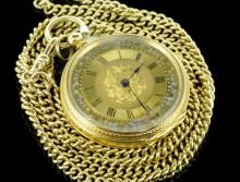 Ladies' decorative pocket watch, gilt dial with Roman numerals and decorative floral detail, manual wind movement, base metal dust cover, with an outer yellow metal case stamped 18ct, with a yellow metal chain stamped 9ct, pocket watch gross weight approximately 37.6 grams, chain 24 grams