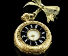 Ladies' demi hunter pocket watch, white dial with Roman numerals, decorative enamel case, yellow metal stamped 14ct, on a silver fob brooch, a/f