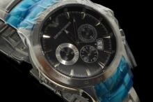 Gentlemen's Armani bracelet wristwatch, textured circular black dial with subsidiary chronograph dials, tachymeter bezel, brushed and polished stainless steel case/bracelet