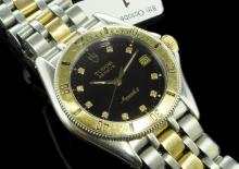18ct yellow gold and stainless steel Tudor Monarch II Jubilee bracelet wristwatch, circular black dial with diamond dot hour markers, date aperture situated at three o'clock, inlaid luminous hands, 18ct yellow gold rotating bezel, case diameter approximately 33mm, Tudor signed Swiss quartz movement, bi-colour bracelet and Tudor signed clasp