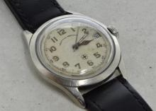 Gentlemen's West End Watch Co wristwatch, circular white dial, applied Arabic numerals, date aperture at three o'clock, signed crown, screwdown caseback, case diameter approximately 34mm