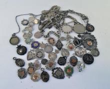 Large quantity of antique and vintage silver fobs, medallions and coins