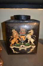A toleware canister painted with the Royal coat of arms