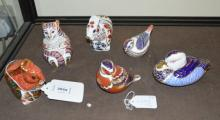 A group of six Royal Crown Derby animals and birds including two squirrels, a lion cub and three birds.