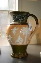 A Doulton Lambeth stoneware jug with Egyptianesque decoration, 24cm.