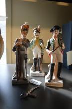 *Three porcelain figures: Officer de Cavalerie, Grenadier de la Garde and Soldat de Infanterie. A Beswick horse and Old Tupton Ware vase with embossed flower decoration (5) (Subject to VAT)