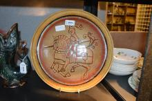 A Diana Davis 'Aegean' plate, decorated with a jousting knights, 31.5cm diam.