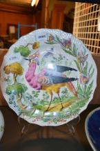 A pearlware plate overpainted in Chelsea red anchor style with a bird of paradise, the reverse with inscription: