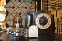 *A Smiths Enfield mantle clock with a small cream clock, a very small yellow metal pocket watch with three barometers and mounted compass (7)
