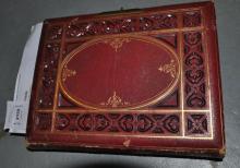 A carte-de-visite album in red leather