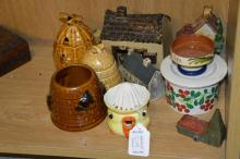 A collection of porcelain including a lemon juicer in the shape of a chick, three beehive shaped shaped honey pots, Arabia sugar bowl with cherry decor and five small models including farmhouse and church (11) together with two Persian style small inlaid boxes, one of which contains a group of small stone eggs, a wooden box with Taj Mahal carving, a vintage Oxo tin and a pair of wooden chopsticks