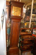 An oak longcase clock with square hood, flanked by columns enclosing a brass face with Roman hours and date aperture, etched Nathan Edge, Colchester, 44cm wide, 187cm long, 23cm deep